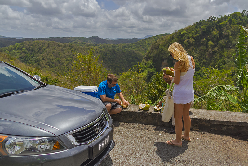 St. Lucia Tours - Coconut eating couple